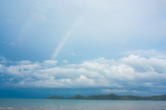 Tropical beach. Colorful rainbow over tropical beach royalty free stock image