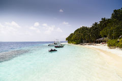 Tropical beach with crystal clear water Royalty Free Stock Images