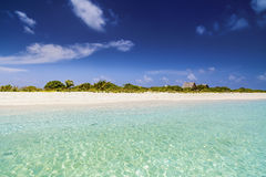 Tropical beach with crystal clear water Stock Photos