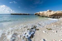 Tropical beach on a desert island Stock Photos