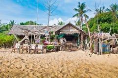 Tropical Beach Dining. Barefoot beach dining at a beach shack restaurant in Koh Samui Thailand Stock Image