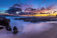 Tropical Beach At Dusk. Tropical beach at sunset. This photo was taken from Secret Cove on the tropical island of Maui, Hawaii at Dusk. the long exposure made Royalty Free Stock Photography