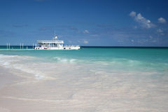 Tropical beach and ferry Royalty Free Stock Image