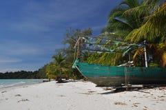 Tropical beach and fishing boat, Koh Rong, Cambodia Royalty Free Stock Photos