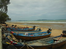 Tropical beach and fishing boats Royalty Free Stock Photos