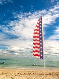 Tropical beach and flag of USA Stock Photos