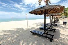 Tropical beach getaway. Beach huts on a tropical beach Stock Image