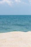 Tropical beach getaway. Sandy beach with horizon over blue sea background Stock Image