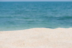 Tropical beach getaway. Sandy beach and horizon over water background Stock Photo