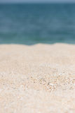 Tropical beach getaway. Sandy beach and horizon over water background Stock Images