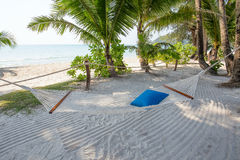 Tropical beach and hammock on the island Koh Kood, Thailand Stock Photos