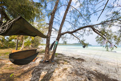 Tropical beach and Hammock in Ko Rong with sand and palm trees Royalty Free Stock Photo