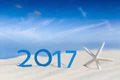 Tropical beach and 2017 happy new year. Season vacation, holiday concept. Sunny tropical beach and 2017 happy new year. Season vacation and holiday concept Stock Images
