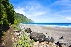 Tropical beach with hiking trail Stock Image