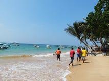 Tropical beach in Hikkaduwa. Sri Lanka. Tropical beach with palms in Hikkaduwa. Sri Lanka Royalty Free Stock Photography
