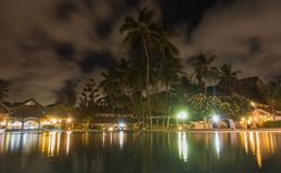 Tropical beach Hotel pool illuminated night view Royalty Free Stock Images