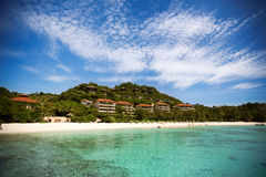 Tropical beach with hotels Royalty Free Stock Photo