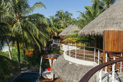 Tropical beach house on the island. In Maldives Royalty Free Stock Photo