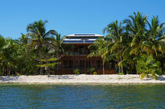 Tropical beach house with solar panels on the roof Stock Photos