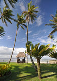 Tropical beach hut. The tranquil beaches of the  South Pacific Ocean really are paradise found. This thatched beach hut overlooks the Coral Coast on the island Stock Photos