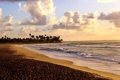 Free Tropical Beach In The Late Afternoon. Sky With Clouds And Choppy Waves. Royalty Free Stock Image - 196973616