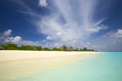 Tropical beach in the Indian Ocean,. Coral tropical beach on the island Kuredu in the Indian Ocean, Maldives royalty free stock photo