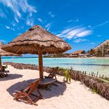 Tropical beach in Isla Mujeres, Mexico. Tropical sea on famous Playa del Norte beach in Isla Mujeres, Mexico. The island is located 8 miles northeast of Cancún Royalty Free Stock Photos