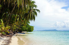 Tropical beach island with a boat Stock Photography