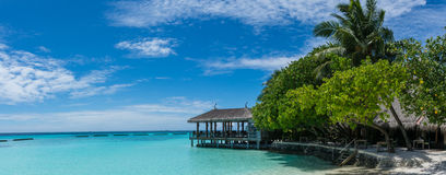 Tropical beach island panorama with hut at Maldives. Tropical beach island beautiful panorama with wooden hut at Maldives Royalty Free Stock Photos