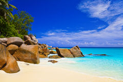 Tropical beach at island Praslin, Seychelles. Vacation background Royalty Free Stock Photos