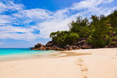 Tropical beach at island Praslin Seychelles. Vacation background Royalty Free Stock Images