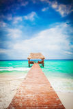 Tropical Beach with jetty. Mexico. Riviera Maya. Vacations and tourism concept: Caribbean Paradise stock photos