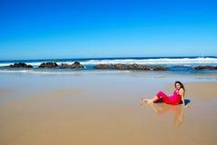 Woman lying on beach Stock Photos