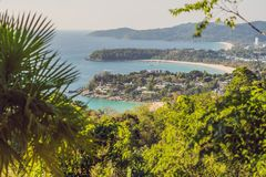Tropical beach landscape panorama. Beautiful turquoise ocean wai. Ves with boats and sandy coastline from high view point. Kata and Karon beaches, Phuket Stock Images