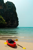 Tropical beach landscape with red canoe boat Royalty Free Stock Photo