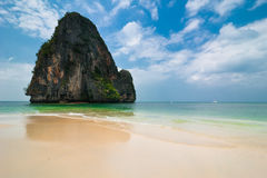 Tropical beach landscape with rock formation island and ocean Stock Photos