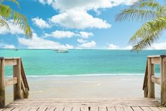 Tropical beach landscape view in sunny day. Sunny beach landscape with sea, palm trees and blue Sky stock image