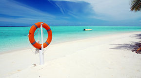 Tropical beach and lifebuoy panorama Stock Photography