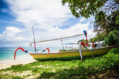 Tropical beach and local boat in Bali Stock Photo