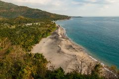 Beach near Sengiggi, Lombok, Indonesia with wide sandy foreground area - colour version stock images