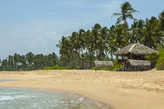 Tropical beach with low key restaurant royalty free stock photography