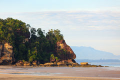 Tropical beach at low tide sunrise Stock Photography