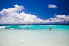 Tropical beach, man enjoy turquoise waves of ocean Royalty Free Stock Photos