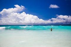 Tropical beach, man enjoy turquoise waves of ocean Royalty Free Stock Photos
