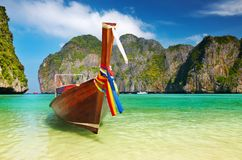 Tropical beach, Maya Bay, Thailand. Tropical beach, traditional long tail boat, Maya Bay, Thailand Royalty Free Stock Image