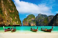 Tropical beach, Maya Bay, Thailand. Tropical beach, traditional long tail boats, famous Maya Bay, Thailand royalty free stock photos
