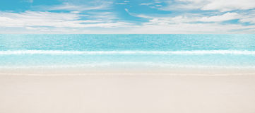 Tropical beach and ocean. Panoramic shot Royalty Free Stock Photography