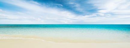 Tropical beach and ocean Stock Photos