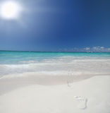 Tropical Beach and Ocean with footprints Royalty Free Stock Images