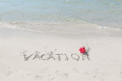 Tropical beach and ocean with message written on the sand Royalty Free Stock Photography